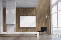 Wooden living room, TV set, fireplace. Modern living room interior with concrete and wooden walls, a concrete floor, loft windows and a fireplace. A poster above Stock Photo