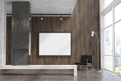 Wooden living room, TV set, gray fireplace. Modern living room interior with concrete and dark wooden walls, a concrete floor, loft windows and a fireplace. A Stock Photos