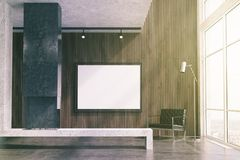 Wooden living room, TV set, gray fireplace toned. Modern living room interior with concrete and dark wooden walls, a concrete floor, loft windows and a fireplace Royalty Free Stock Photography