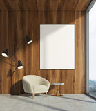 Wooden living room, white armchair, poster Stock Images