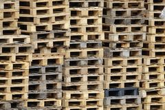 Wooden loading pallets stacked on each other stock photo
