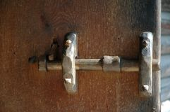 Old wooden lock made of oak. Wooden lock at old door, stone age construction made of oak wood Stock Photos