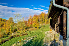 Wooden lodge in autumn mountain nature Stock Images