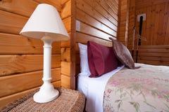 Wooden lodge bedroom interior detail Stock Photo
