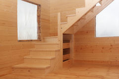 Wooden loft stairs in corner under conctruction Royalty Free Stock Photos