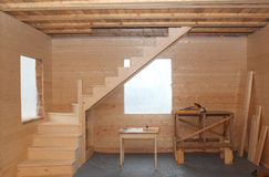Wooden loft stairs under conctruction - working place Royalty Free Stock Photography