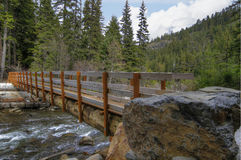 Wooden Log Bridge over River. In Mount Hood Scenic Area Royalty Free Stock Images