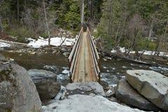 Wooden Log Bridge over River. Wooden Log Foot Bridge Over River in Mount Hood Scenic Area Royalty Free Stock Image