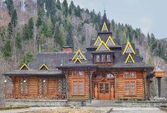 Wooden log building, restaurant Huzulschyna in Yaremche Stock Photo