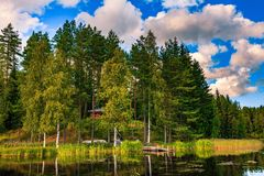 Wooden log cabin on the lake in Finland Royalty Free Stock Image