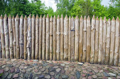 Wooden log fence in resort park Royalty Free Stock Image