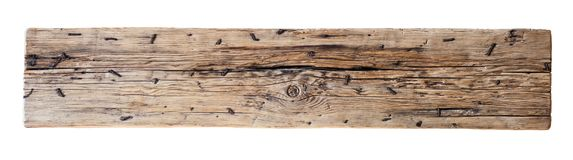Wooden log with nails isolated with clipping path. Old, weathered wooden log with nails isolated with clipping path included stock image
