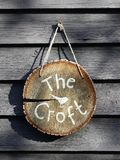 Wooden log sign reading The Croft stock photo