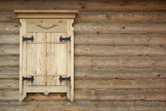 Wooden log wall with closed window. Stock Photos