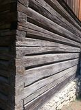 Wooden log walls at external corner, on stone footing to rural house, Village Museum, Bucharest Stock Photos