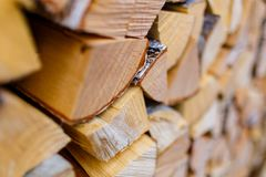 Wooden logs cut into parts close-up. Wooden material texture royalty free stock photo
