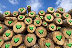Wooden Logs with Green Hearts Stock Image