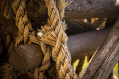 Wooden logs knotted together. Wooden logs knotted together with a weathered rope to make a ladder Stock Image