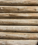 Wooden logs wall. Detail of wooden wall built with logs stock photography