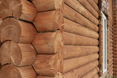 Wooden logs wall of rural house background Stock Images
