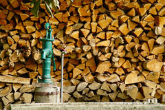Wooden Logs And Water Pump Royalty Free Stock Image