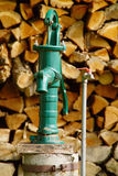 Wooden Logs And Water Pump Stock Photos