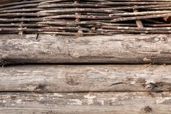 Wooden logs and wattle wall Royalty Free Stock Photography