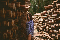 Wooden Logs And A Woman Stock Image