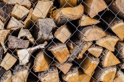 Wooden logs. Wood pile reserve for the winter concept. Pile of chopped firewood from trees. Nature background texture of wood.  Wooden logs wall close up view royalty free stock image