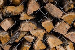 Wooden logs. Wood pile reserve for the winter concept. Pile of chopped firewood from trees. Nature background texture of wood.  Wooden logs wall close up view stock images