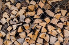 Wooden logs. Wood pile reserve for the winter concept. Pile of chopped firewood from trees. Nature background texture of wood.  Wooden logs wall close up view royalty free stock images