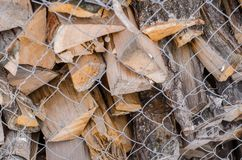 Wooden logs. Wood pile reserve for the winter concept. Pile of chopped firewood from trees. Nature background texture of wood.  Wooden logs wall close up view royalty free stock photos