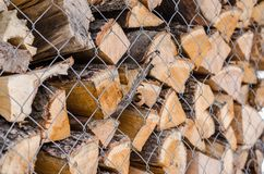 Wooden logs. Wood pile reserve for the winter concept. Pile of chopped firewood from trees. Nature background texture of wood.  Wooden logs wall close up view stock photography