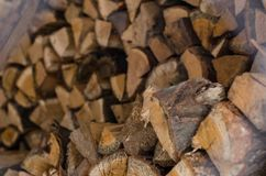 Wooden logs. Wood pile reserve for the winter concept. Pile of chopped firewood from trees. Nature background texture of wood.  Wooden logs wall close up view stock photos