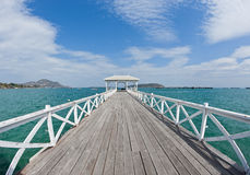 Wooden long bridge reach out the sea Stock Photography
