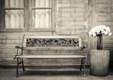 Wooden long chair with wall. Royalty Free Stock Image
