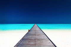 Wooden long jetty over lagoon with amazing clean water Stock Photography
