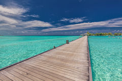 Wooden long jetty over lagoon in Maldives with amazing water. Wooden long jetty over lagoon in Maldives with amazing clean water Stock Image