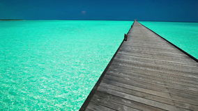 Wooden long jetty over lagoon in Maldives with clean water stock footage