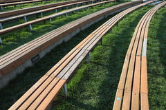 Wooden Long Seats in lines. Wooden long seats of an outdoor bleacher Stock Images
