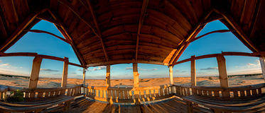 Wooden lookout alcove overlooking the sandy desert Stock Images
