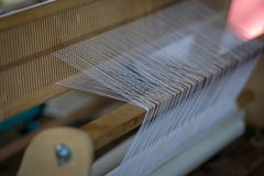 Wooden loom as an equipment for manual fabric manufacture.  royalty free stock photo