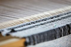 Wooden loom as an equipment for manual fabric manufacture. Close-up stock photo
