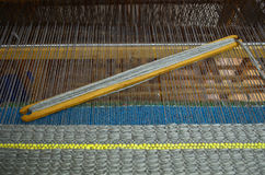 Wooden loom tools on a loom Stock Image