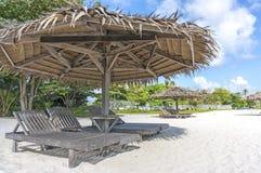Wooden lounge. Beach umbrella at Mabul Island, Sabah Malaysia Royalty Free Stock Images