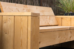 Wooden lounge bench made of construction wood. Royalty Free Stock Image