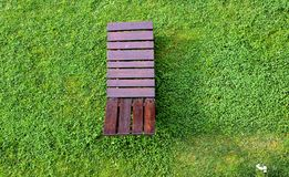 Wooden lounge chair on the green grass Stock Photo