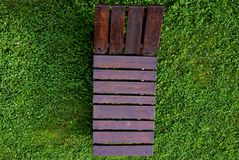 Wooden lounge chair on the green grass Stock Images