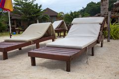 Wooden lounge chairs at beach. Photo take on 2018 Royalty Free Stock Images