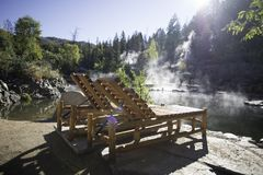 Wooden Lounge Chairs Near A Hot Spring Royalty Free Stock Photography